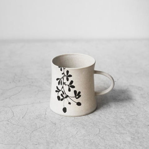 "Illustrated Black and White Ceramic Cup with Handle ""Petals"""