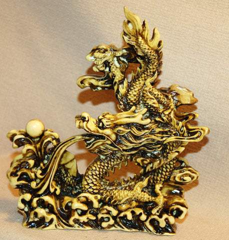 Resin Dragon Holding Pearl of Wisdom