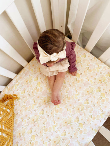Cot sheet with baby