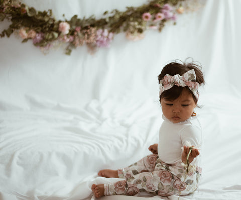 little girl in Briar Rose baby leggings and headband