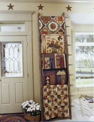 Quilts displayed on a ladder