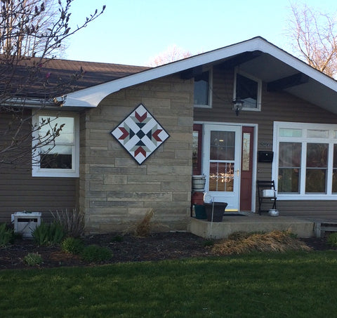 barn quilt on front of house