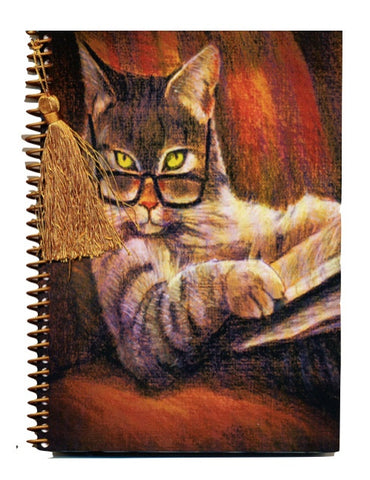 Cat in glasses reading notebook journal