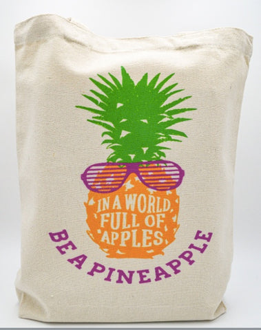 In a World of Apples, be a Pineapple tote bag