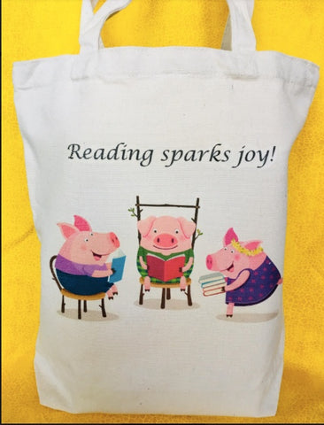 Reading Sparks Joy! Pigs reading Tote Bag