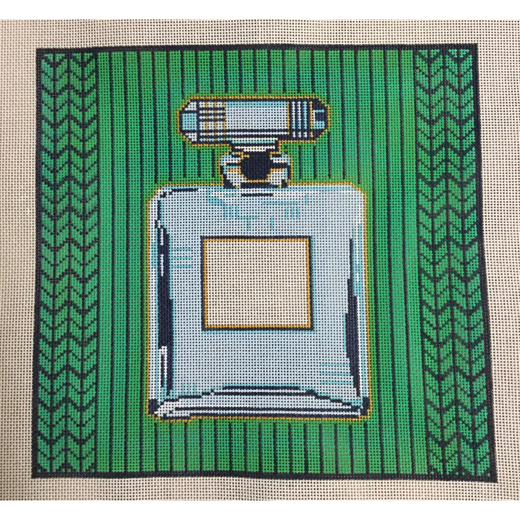 Perfume Bottle on Green Needlepoint Canvas