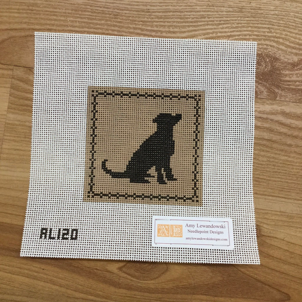 Black Lab Sitting on Tan Canvas