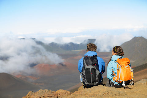 hikers overlooking volcano