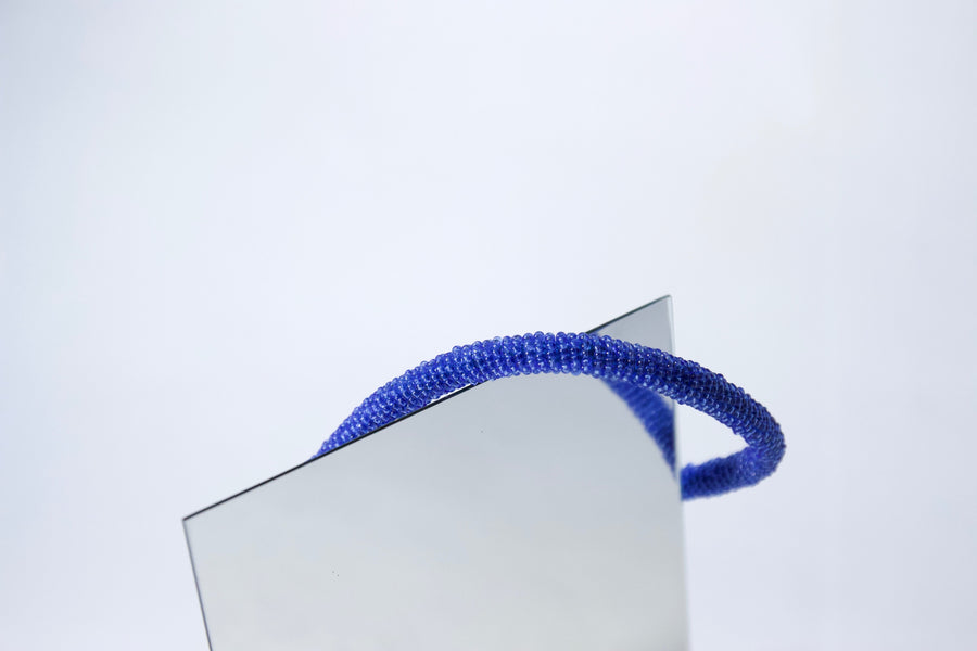 Cotton cord hand appliquéd with azure miniature glass beads by Gré