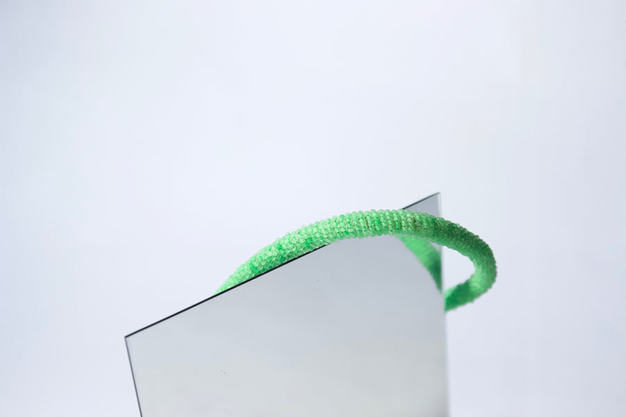 Cotton cord hand appliquéd with apple green miniature glass beads by Gré
