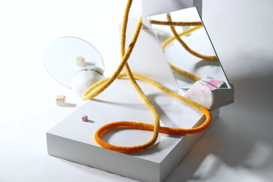 Loop necklace in orange-yellow duo