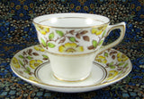 Hand Colored Rosina England Cup and Saucer Yellow Dog Roses On Brown Transfer