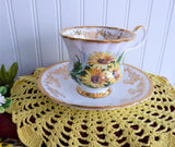 Fancy Yellow Daisies Cup And Saucer Gold Overlay English Bone China 1950s Windsor