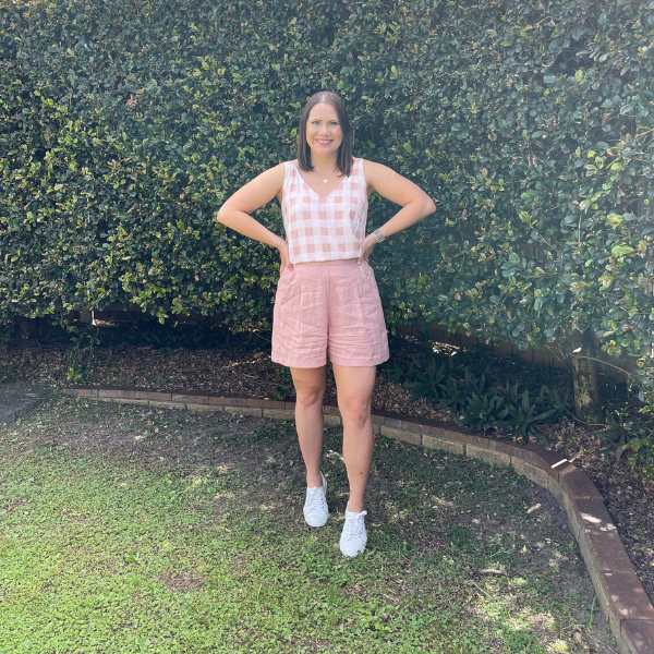 Bec in our Nadia linen shorts - peach and our Violet cami - peach check