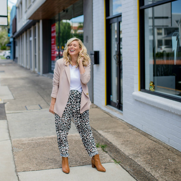 Brooke wearing our Kerryn blazer in blush with our Angela animal print pants and a white tee.