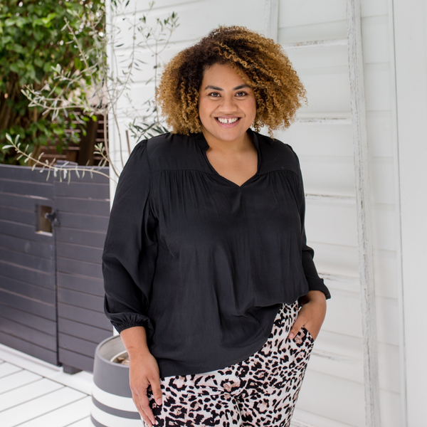 Asinate wearing our Felicity technical blouse in black.