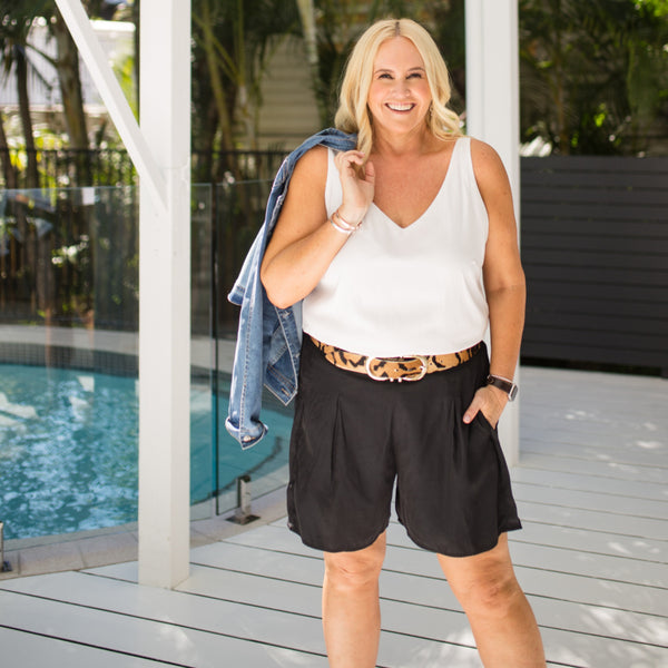 Nikki in Rachael technical cami white and our Bec technical shorts