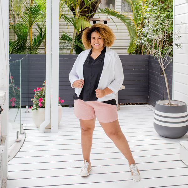 Asinate wearing our Caroline linen blazer in white with our Nadia linen shorts in peach