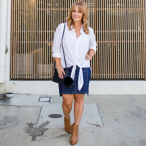 Karen wearing our Cate white shirt paired with our Johanne dark denim skirt