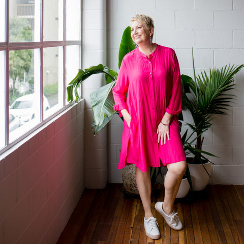 Susan wearing our Danielle technical shirt dress in Raspberry