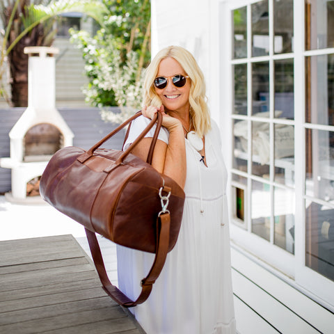 Nikki with her Zurii brown leather weekend bag