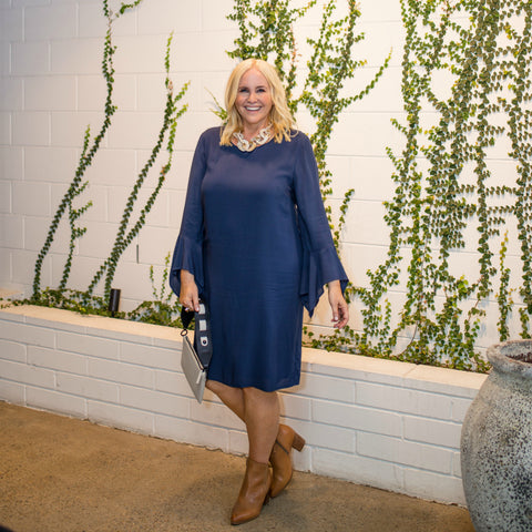 Nikki Parkinson wearing our Janet Navy bell sleeve dress