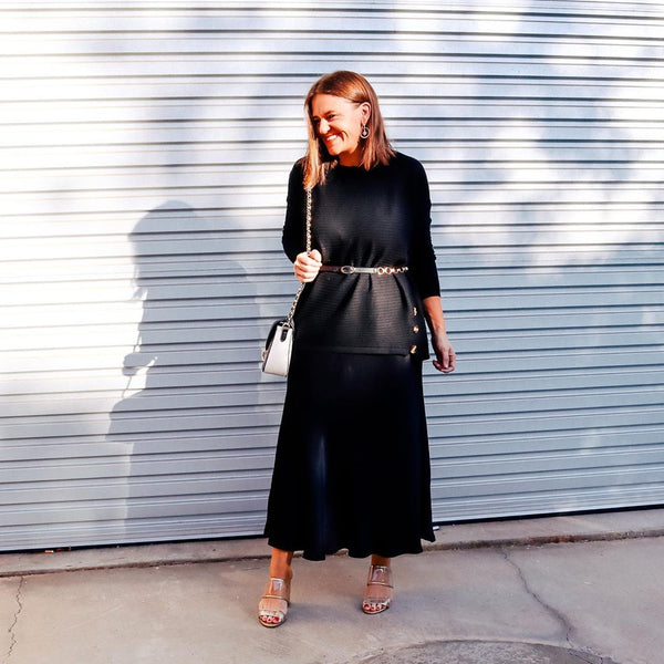 Jasmine wearing our Deborah midi satin skirt with a black tee and belt