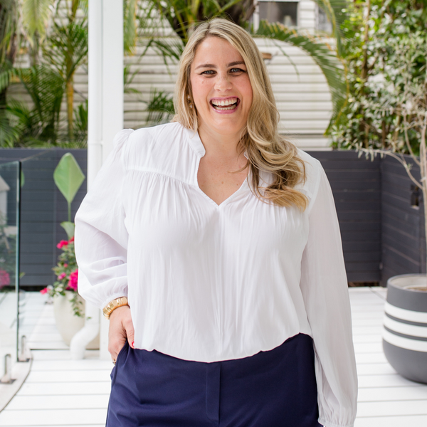 Jess wearing our Felicity billow sleeve blouse in white.