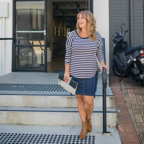 Karen wearing our Johanne stripe long-sleeve tee and Johanne dark denim skirt