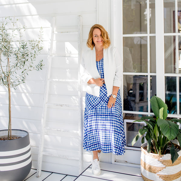 Karen in our Ashlee midi skirt gingham, our Karen Scuba jacket in ivory and our Alex gingham cami