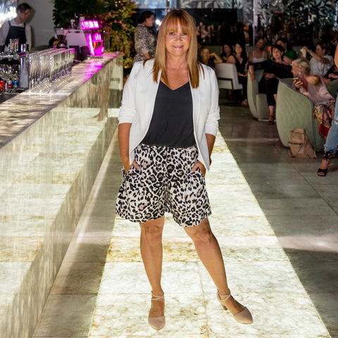 Karen our size 12 model walking the runway in her name sake scuba jacket and animal print short