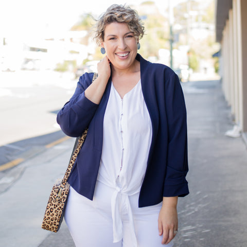 Jo from ICurvy wearing our Nicole blouse in white under a Karen jacket in navy