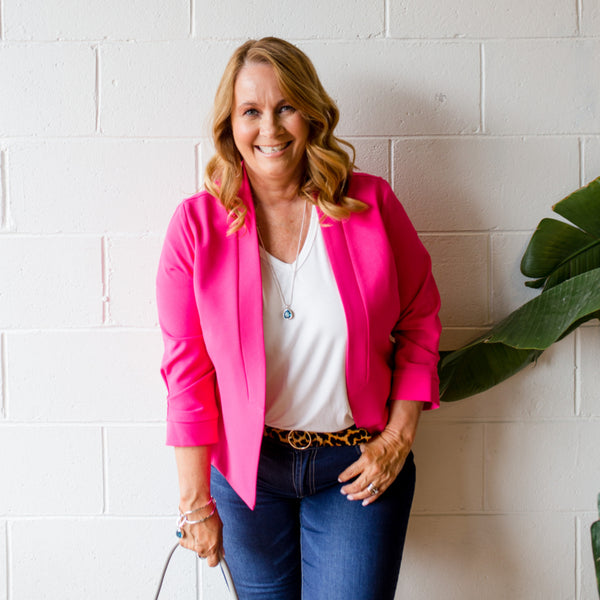 Karen wearing a pink blazer over our white Alexa tee and jeans