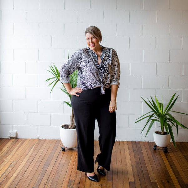 Jo wearing our Sally Safari shirt over our Laura pants in black
