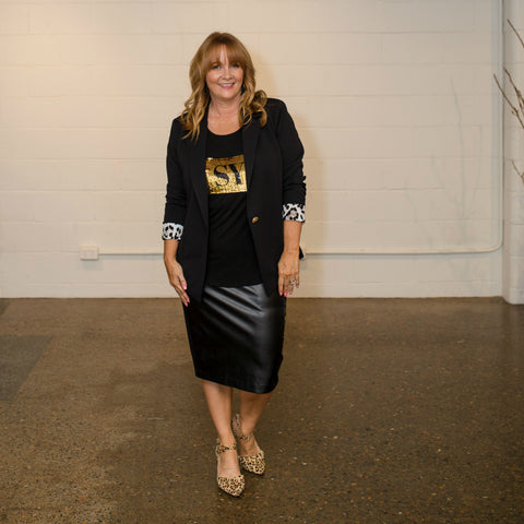 Karen wearing our Kerryn blazer in black, Nikki sequin tee and Lisa skirt