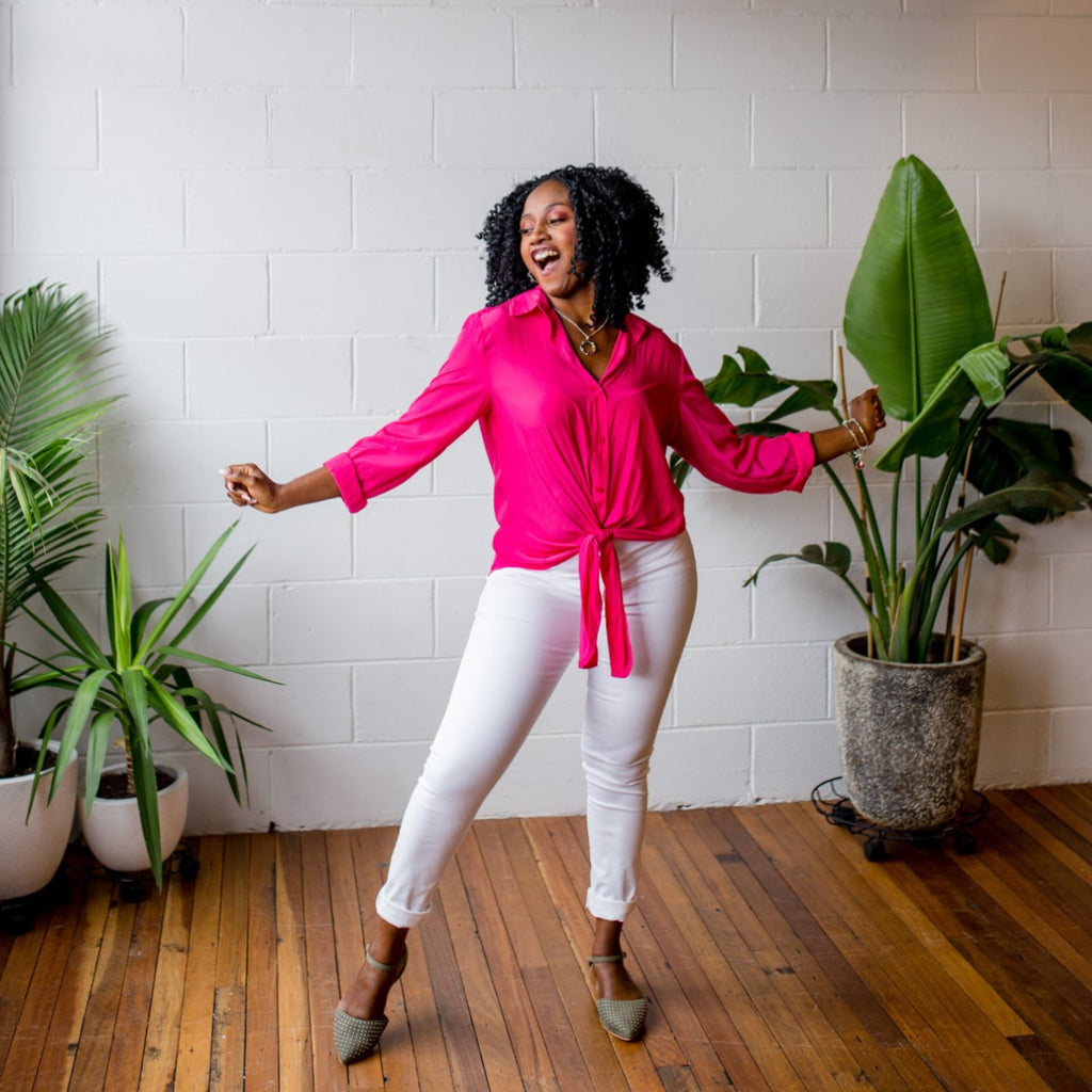 Sonia dancing in our white Margaux jeans and Raspberry Cate technical shirt