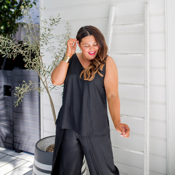 Stacey in our Rachel black technical cami and our Maria black technical split pants