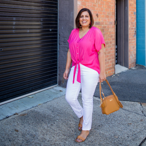 Jayanita wearing Margaux jeans and Nicole blouse in Raspberry