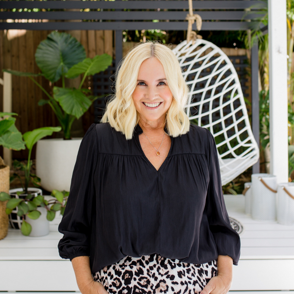 Nikki our size 12 model wearing our Felicity blouse in black