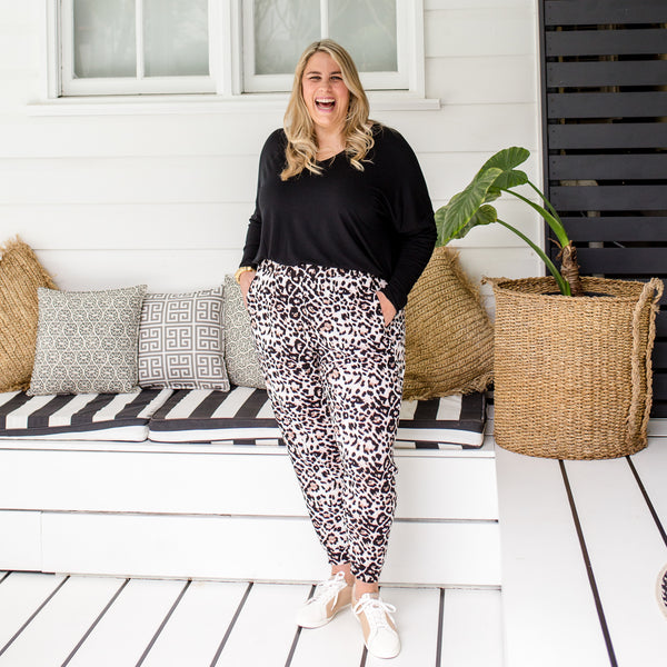 Jess in our Sharon relaxed long-sleeve tee - black and our Leanne joggy pant animal print
