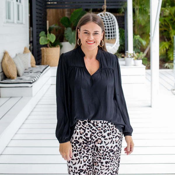 Jess in our Felicity technical billow blouse - black and our Leanne joggy pant - animal print