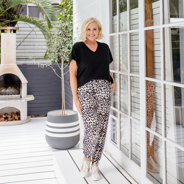 Nikki in our Alexa relaxed tee - black and our Leanne joggy pant animal print
