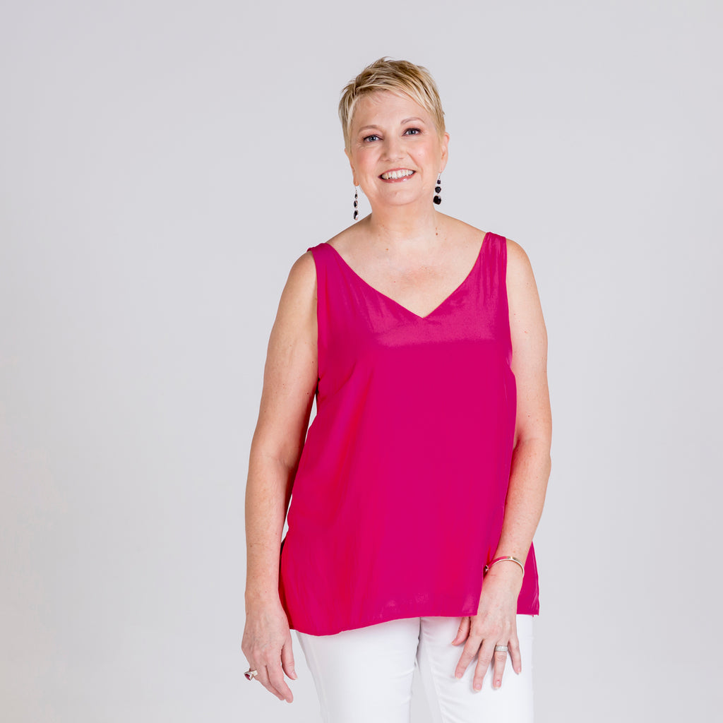 Rachael technical cami in raspberry and Margaux white denim jeans.