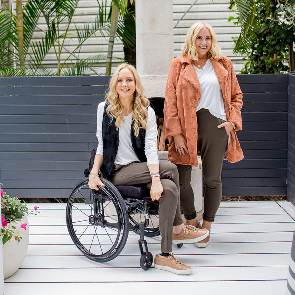 Nikki and Lisa in our Suzie ponte jogger pant - khaki, our Sharon relaxed long sleeve tee - white, our Joanne faux fur gilet - black and our Constance faux fur coat - caramel