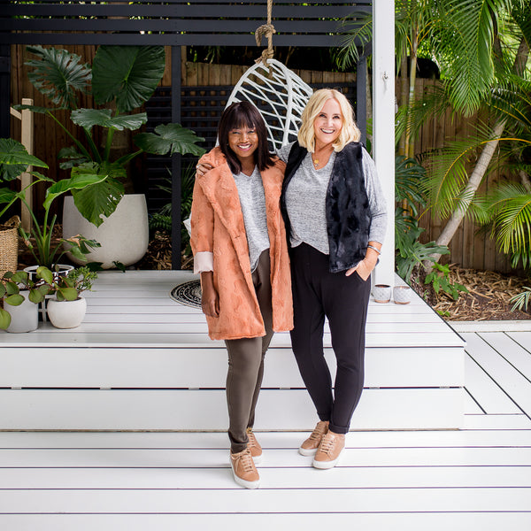 Nikki and Sonia in our Suzie ponte jogger pant - khaki, our Jenny swing knit - grey, our Joanne faux fur gilet - black and our Constance faux fur coat - caramel