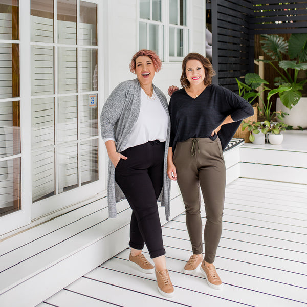 Jo and Bec in our Suzie ponte jogger pant - khaki, our Sharon relaxed long sleeve tee - white, our Jelena long line cardigan - grey and our Jenny swing knit - black