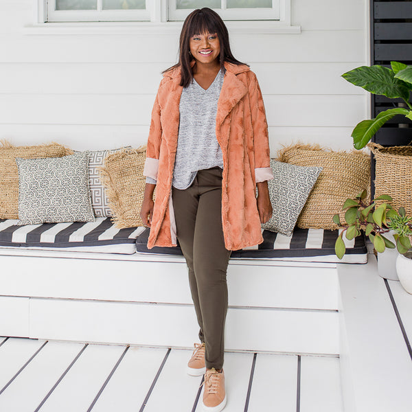 Sonia in our Suzie ponte jogger pant - khaki, our Jenny light swing knit - grey marle and our Constance faux fur coat - caramel