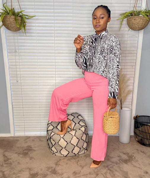 Sonia wearing styling you the label's Sally safari shirt with fluro pink straight leg pants