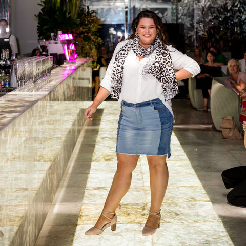 Stacey our size 16 model with long brown hair walking the catwalk in our beth skirt and cate shirt