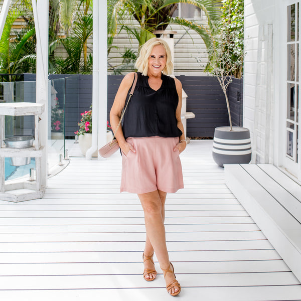Nikki in our Nadia linen shorts - peach and our Stevie technical sleeveless blouse - black